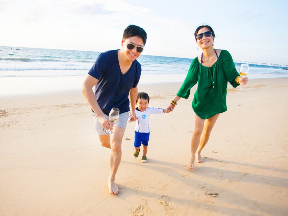 Joyce's family during holiday time in Natai beach Phuket Thailand.